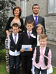 Twins Hakan and Fidan Topcu who received First Holy Communion in St. Cianan's church Duleek pictured with parents Atakan and Fiona and brothers Elmre and Ali. Photo: Colin Bell/pressphotos.ie