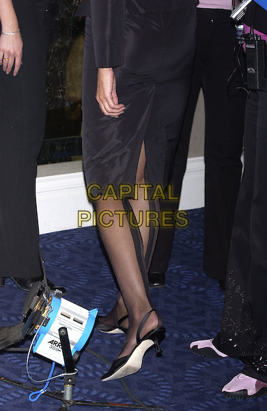 JERRY HALL.Arriving  to host the Breast Cancer Care Fashion Show at Grosvenor House, Park Lane, London, October 6th 2004..close up legs shoes.Ref: PL.www.capitalpictures.com.sales@capitalpictures.com.©Capital Pictures.