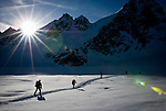 A group of skiers traverse the Mont Collon Glacier on the final day of the Haute Route traverse in Switzerland.