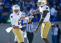 William Fuller (15) celebrates with wide receiver DaVaris Daniels (10) after his touchdown.
