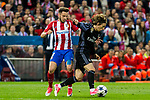 Luka Modric of Real Madrid holds off pressure from  Saul Iniguez of Atletico de Madrid during the match of Champions League between Atletico de Madrid and Real Madrid at Vicente Calderon Stadium in Madrid, May 10, 2017. Spain.