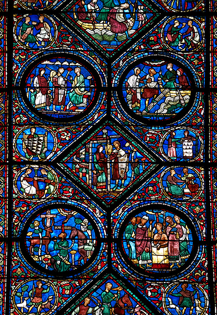 Medieval stained glass Window of the Gothic Cathedral of Chartres, France - dedicated to the life of Eustace . Central panel shows act 2 ?the Tragedy and Exile? , central diamond - After various disasters, Eustace and his family abandon their home. Top Right - possibly Eustace negotiating passage to Egypt , top right - Eustace and his family board a boat to Egypt.  Bottom left from act one ?the Conversion:?- Placidus hears the words of Christ coming from the mouth of a stag, right - Placidus is baptised and given the name 'Eustace'. A UNESCO World Heritage Site.