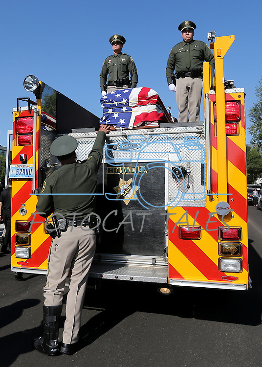 Carson City Sheriff's Deputy Bob Guimont touches the casket Deputy Carl Howell in front of the Sheriff's Office in Carson City, Nev., on Thursday, Aug. 20, 2015. Howell was shot and killed early Saturday morning after responding to a domestic violence call. (Cathleen Allison/Las Vegas Review-Journal)