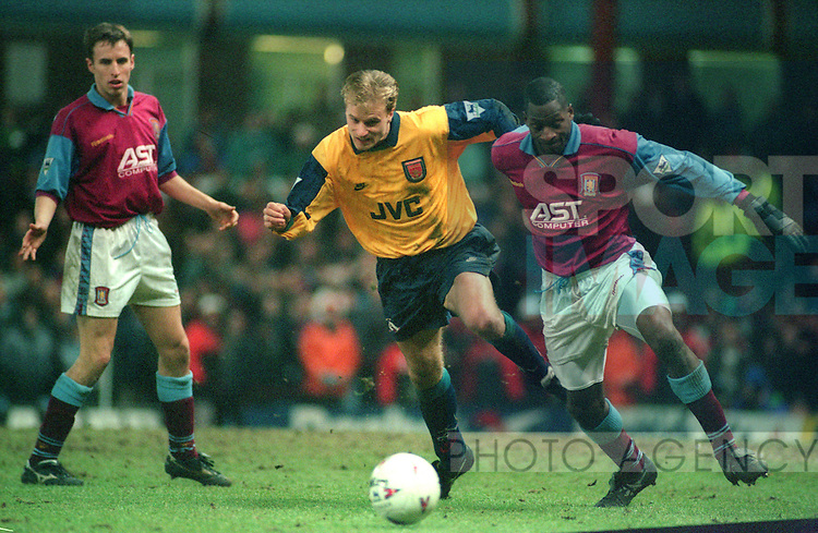 Dennis Bergkamp of Arsenal battles with Ugo Ehiogu of Aston Villa -  Coca Cola Cup Semi Final - Aston Villa v Arsenal - Villa Park Stadium - Birmingham - England - 21st  February 1996 - Picture Simon Bellis/Sportimage
