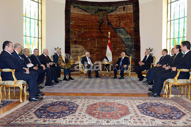 Palestinian President Mahmoud Abbas meets with Egyptian interim President Adly Mansour, right,  at the Presidential Palace in Cairo, Egypt, Monday, July 29, 2013. Israeli and Palestinian teams will try again in preliminary talks today to get Middle East peace talks back on track after two decades of failure. Both sides have flown to Washington but each group says many obstacles need to be overcome. Photo by Thaer Ganaim