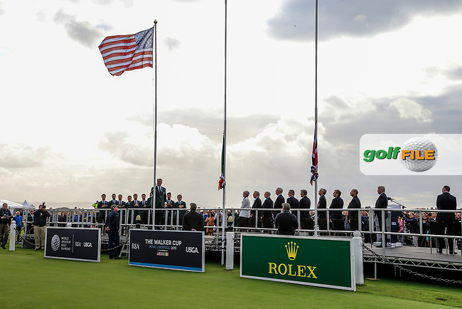Nathaniel Crosby (GB&I Captain) raises the USA flag during the opening ceremony at the Walker Cup, Royal Liverpool Golf CLub, Hoylake, Cheshire, England. 06/09/2019.<br /> Picture Fran Caffrey / Golffile.ie<br /> <br /> All photo usage must carry mandatory copyright credit (© Golffile   Fran Caffrey)