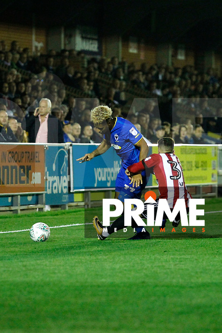 Brentford's Ilias Chatzitheodoridis has hold of AFC Wimbledon's Lyle Taylor during the Carabao Cup match between AFC Wimbledon and Brentford at the Cherry Red Records Stadium, Kingston, England on 8 August 2017. Photo by Carlton Myrie.