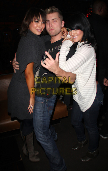 "CHERYL BURKE, LANCE BASS  & LACEY SCHWIMMER.""Dancing With The Stars""  Home Coming Party held at The Abbey, West Hollywood, CA, USA, .13th February 2009..full length grey gray sweater jumper white top knitted polo neck roll dress jeans boots hand gesture .CAP/ADM/KB.©Kevan Brooks/Admedia/Capital PIctures"