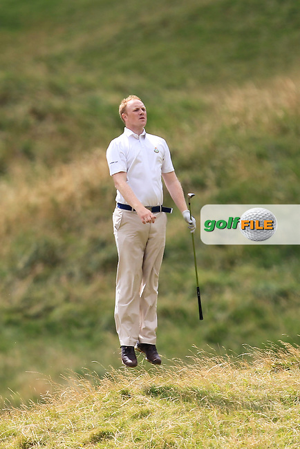 Bryan McSweeney (The Royal Dublin) in the rough on the 15th during the South of Ireland Amateur Open Championship 5th Round at Lahinch Golf Club  30th July 2013 <br /> Picture:  Thos Caffrey / www.golffile.ie