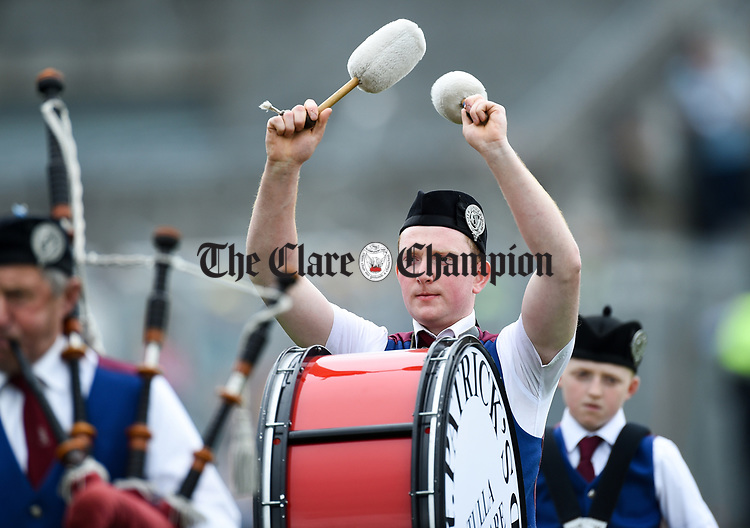 David Murphy of the Tulla Pipe Band performing before the Munster  championship round robin game against Waterford at Cusack Park Photograph by John Kelly.