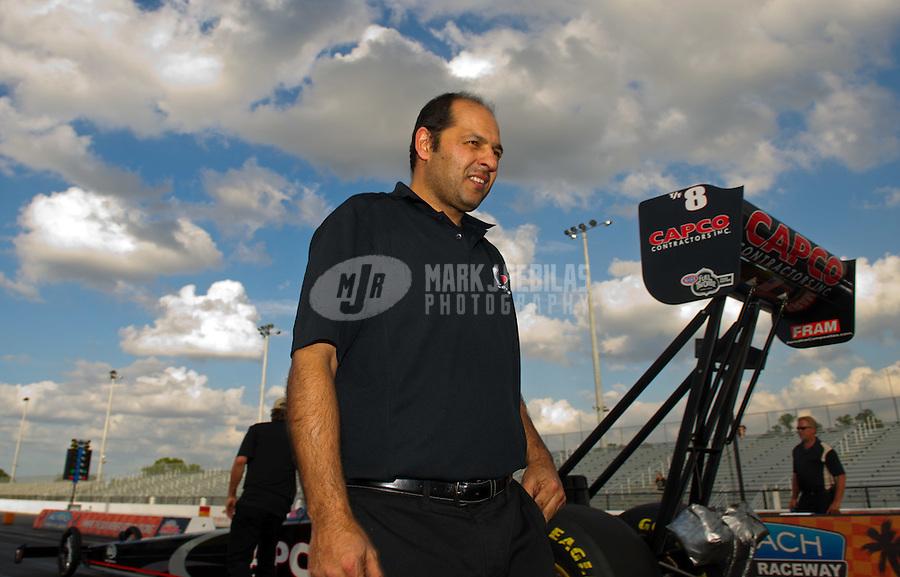 Jan. 18, 2012; Jupiter, FL, USA: A crew member for NHRA top fuel dragster driver Steve Torrence during testing at the PRO Winter Warmup at Palm Beach International Raceway. Mandatory Credit: Mark J. Rebilas-
