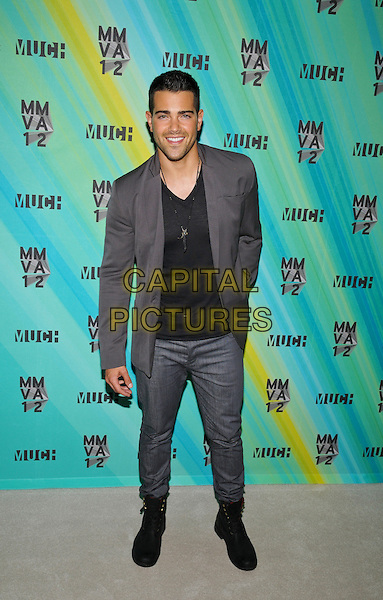 Jesse Metcalfe poses in the press room at the 23rd Annual MuchMusic Video Awards at the MuchMusic HQ, Toronto, Ontario, Canada. .June 17th, 2012.full length black top grey gray suit jacket hand in pocket trousers suit.CAP/ADM/BPC.©Brent Perniac/AdMedia/Capital Pictures.