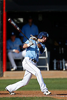 Logan Davis #13 of the University of San Diego Toreros bats against the Cal State Northridge Matadors at Matador Field on March 26, 2013 in Northridge, California. (Larry Goren/Four Seam Images)