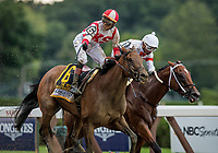 SARATOGA SPRINGS, NY- AUGUST 04: Jose Ortiz celebrates winning the Test Stakes at Saratoga Racecourse on August 4, 2018 in Saratoga Springs, New York.(Photo by Alex Evers/Eclipse Sportswire)