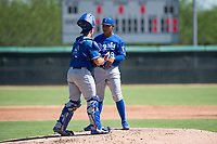Kansas City Royals relief pitcher Angel Zerpa (49) talks to catcher Chase Vallot (3) during an Instructional League game against the Chicago White Sox at Camelback Ranch on September 25, 2018 in Glendale, Arizona. (Zachary Lucy/Four Seam Images)