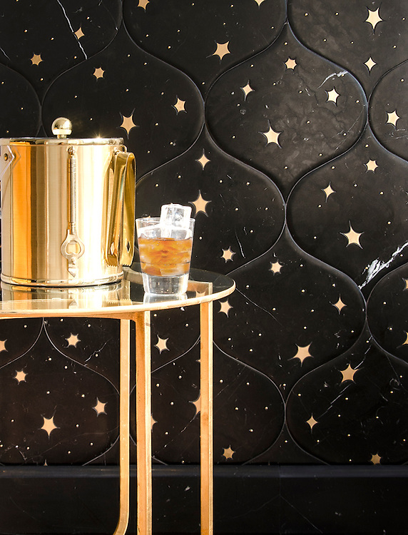 Astronomy, a waterjet stone mosaic, shown in Venetian honed Nero Marquina and Brass, is part of the Trove® collection for New Ravenna.