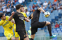 Roma s Edin Dzeko, right, kicks the ball during the Italian Serie A football match between Roma and Chievo Verona at Rome's Olympic stadium, 28 April 2018.<br /> UPDATE IMAGES PRESS/Riccardo De Luca