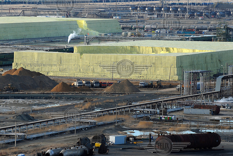 Sulphur storage pits at an oil refinery on the edge of the Caspian Sea. Sulphur is an inevitable by-product of drilling in this region and is sold on to markets elsewhere for use as fertilizer.