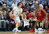 CHAPEL HILL, NC - FEBRUARY 25: Cole Anthony #2 of the University of North Carolina is defended by C.J. Bryce #13 of North Carolina State University during a game between NC State and North Carolina at Dean E. Smith Center on February 25, 2020 in Chapel Hill, North Carolina.