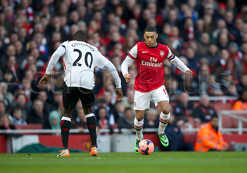 16.02.2014 London, England. Alex Oxlade-Chamberlain of Arsenal (r) looks to run at Aly Cissokho of Liverpool  during the FA Cup 5th Round game between Arsenal and Liverpool from the Emirates Stadium.