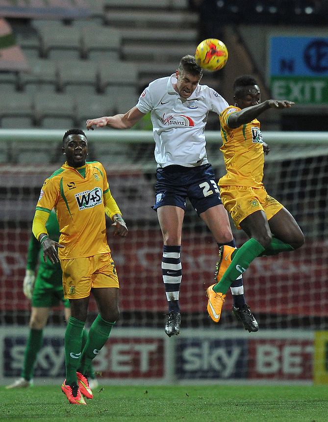 Preston North End's Paul Huntington jumps highest<br /> <br /> Photographer Dave Howarth/CameraSport<br /> <br /> Football - The Football League Sky Bet League One - Preston North End v Yeovil Town - Tuesday 20th January 2015 - Deepdale - Preston<br /> <br /> &copy; CameraSport - 43 Linden Ave. Countesthorpe. Leicester. England. LE8 5PG - Tel: +44 (0) 116 277 4147 - admin@camerasport.com - www.camerasport.com