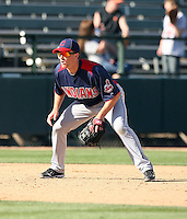 Cord Phelps of the Cleveland Indians plays against the Oakland Athletics in a spring training game at Phoenix Municipal Stadium on March 2, 2011  in Phoenix, Arizona. .Photo by:  Bill Mitchell/Four Seam Images.