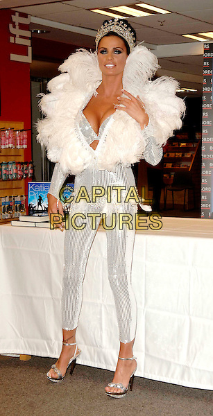 """JORDAN - KATIE PRICE .Launches her new book """"Angel Uncovered"""" at Borders book store, London, England. .July 17th, 2008 .full length silver sequins sequined feathers feathered collar jewel encrusted crown plunging neckline cleavage bra catsuit jumpsuit hand belt.CAP/WIZ.© Wizard/Capital Pictures."""
