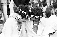 Manhattan, New York City, New York - June 27, 1971<br /> Two men with flowers in their hair enjoy openly showing affection for each other during the 2nd Gay Pride Parade in New York City. Same sex marriage will be legally recognized in May 2013 in New York.
