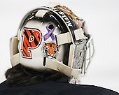 "Colton Phinney (Princeton - 33) has ""Avalanna"" on the back of his mask for Avalanna Routh. He and his EJHL team got to know the child before her death from cancer in 2012. - The Harvard University Crimson defeated the Princeton University Tigers 3-2 on Friday, January 31, 2014, at the Bright-Landry Hockey Center in Cambridge, Massachusetts."