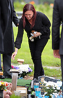 Pictured: A woman leaves flowers after the burial at Thornhill Cemetery, Cardiff, Wales, UK. Tuesday 28 June 2016<br /> Re: The funeral of Sion, the baby boy found dead in the River Taff in Cardiff has taken place<br /> Generous locals raised nearly &pound;1,400 for the memorial after reading about plans to hold a fitting ceremony for the newborn baby whose body was discovered in Cardiff a year ago.<br /> The funeral took place at the Briwnant Chapel at Thornhill Crematorium, Cardiff. Members of the public are invited to be among the congregation.