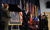 Washington, DC - March 12, 2009 -- United States President Barack Obama and Lt. Gen. Frances C. Wilson, United States Marine Corps, president of the National Defense University, unveil a portrait of Abraham Lincoln during the dedication of the Abraham Lincoln Hall at the National Defense University at Ft. McNair in Washington on Thursday, March 12, 2009. At right are Secretary of Defense Robert Gates and Chairman of the Joint Chiefs of Staff Adm. Michael Mullen.    .Credit: Roger L. Wollenberg - Pool via CNP