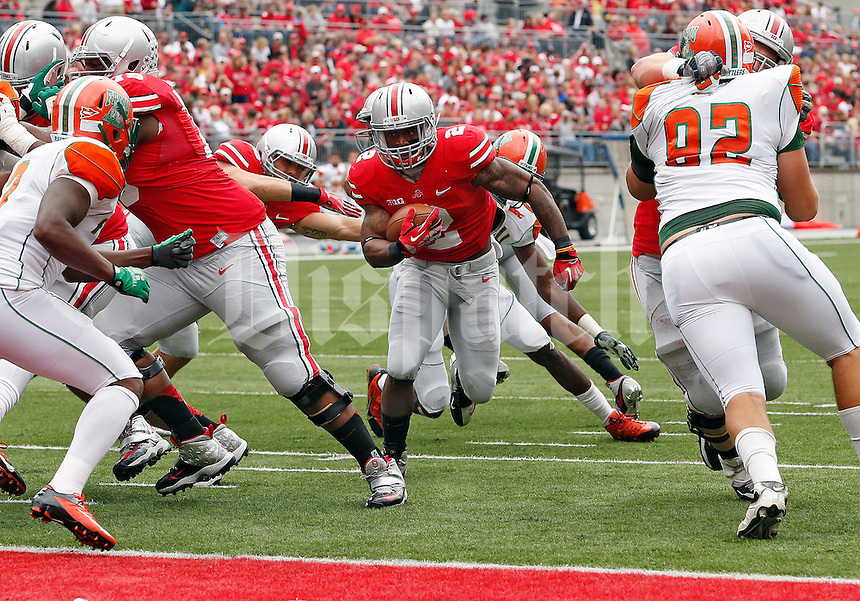 Ohio State Buckeyes running back Jordan Hall (2) scores on a touchdown run against Florida A&M Rattlers in the 1st quarter during their college football game at Ohio Stadium on September 21, 2013.  (Dispatch photo by Kyle Robertson)