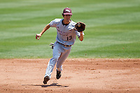 Kevin Medrano (13) of the Missouri State Bears fields a bouncing ground ball during a game against the Wichita State Shockers in the 2012 Missouri Valley Conference Championship Tournament at Hammons Field on May 23, 2012 in Springfield, Missouri. (David Welker/Four Seam Images).