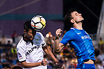 Wai Ho Chan of Dreams FC (C) in action against SC Kitchee Defender Helio de Souza (R) during the week two Premier League match between Kitchee and Dreams FC at on September 10, 2017 in Hong Kong, China. Photo by Marcio Rodrigo Machado / Power Sport Images