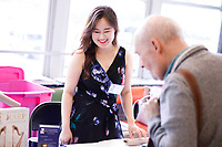 USA International Harp Competition Volunteer Cindy Songwon Lee helps members of the jury check in during the 11th USA International Harp Competition at Indiana University in Bloomington, Indiana on Wednesday, July 3, 2019. (Photo by James Brosher)