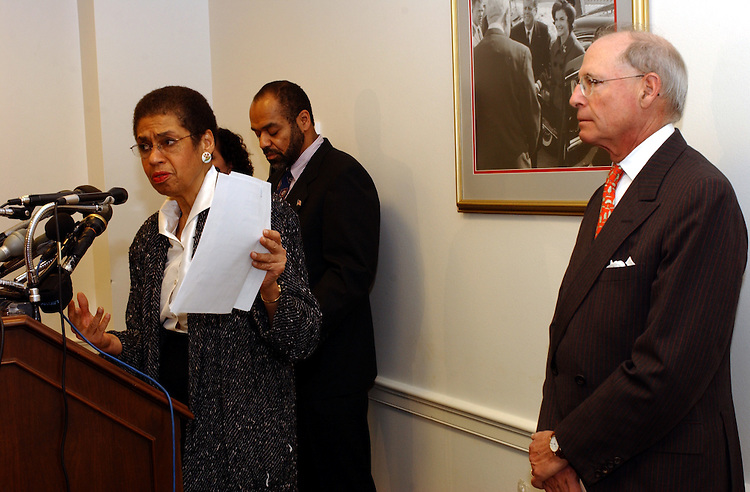 tax1/013102 -- Del. Eleanoe Holmes Norton, D-D.C.; Roscoe Howard, U.S. Attorney for the District of Columbia and IRS Commissioner Charles Rossotti, during a press conference on slavery reparation tax fraud and scams.