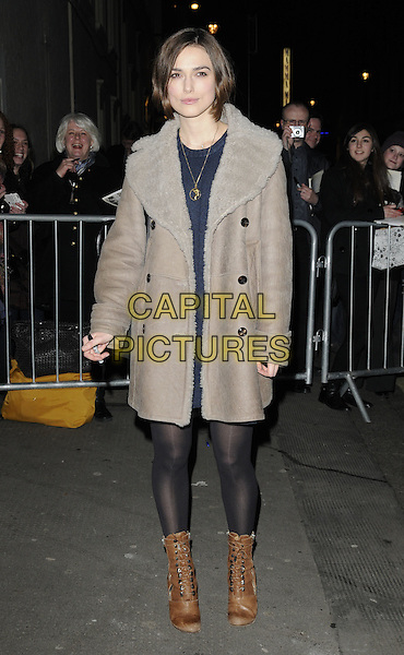 "KEIRA KNIGHTLEY.Departed after an evening performance of ""The Children's Hour"" at the Comedy Theatre, London, England, .March 2nd 2011..full length coat sheepskin coat black tights brown ankle boots shearling suede .CAP/CAN.©Can Nguyen/Capital Pictures."