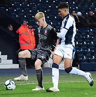 Lincoln City U18's Josh Woodcock shields the ball from West Bromwich Albion U18's Morgan Rogers<br /> <br /> Photographer Andrew Vaughan/CameraSport<br /> <br /> FA Youth Cup Round Three - West Bromwich Albion U18 v Lincoln City U18 - Tuesday 11th December 2018 - The Hawthorns - West Bromwich<br />  <br /> World Copyright &copy; 2018 CameraSport. All rights reserved. 43 Linden Ave. Countesthorpe. Leicester. England. LE8 5PG - Tel: +44 (0) 116 277 4147 - admin@camerasport.com - www.camerasport.com