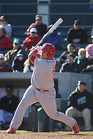 North Carolina State Wolfpack catcher Danny Canela #23 at bat during a game against the Coastal Carolina Chanticleers at BB&T Coastal Field on February 26, 2012 in Myrtle Beach, SC.  Coastal Carolina defeated N.C. State 3-2. (Robert Gurganus/Four Seam Images)