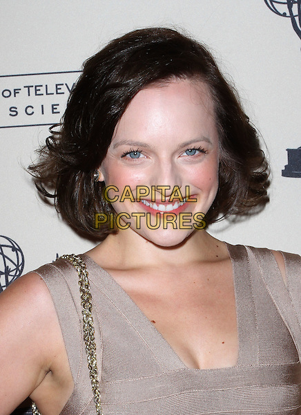 Elisabeth Moss.63rd Primetime Emmy Writers Nominee Reception Held at Leonard H. Goldenson Theatre, North Hollywood, California, USA..September 15th, 2011.headshot portrait beige smiling .CAP/ADM/KB.©Kevan Brooks/AdMedia/Capital Pictures.