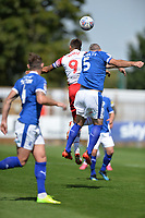 Alex Revell of Stevenage jumps with Steve McNulty of Tranmere Rovers during Stevenage vs Tranmere Rovers, Sky Bet EFL League 2 Football at the Lamex Stadium on 4th August 2018