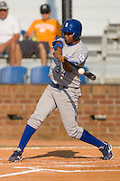 Diego Cruz #34 of the Burlington Royals makes contact with the baseball at Howard Johnson Stadium June 27, 2009 in Johnson City, Tennessee. (Photo by Brian Westerholt / Four Seam Images)
