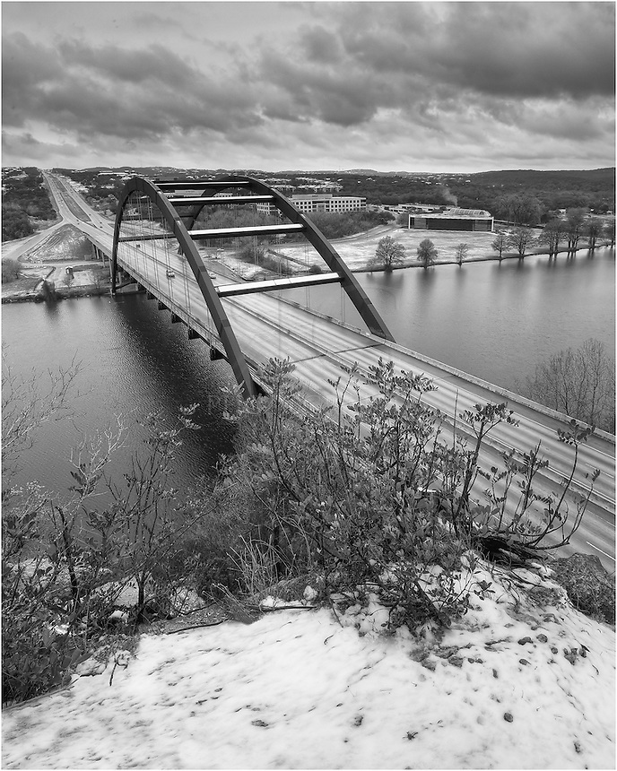 A rare occurrence, snow falls on the 360 Bridge in Austin, Texas. It was a treat to find my way to Pennybacker Bridge on this afternoon and take some images before the snow melted. I had not seen snow up here before, so I enjoyed the sight (and I was glad to warm up at home, too)!