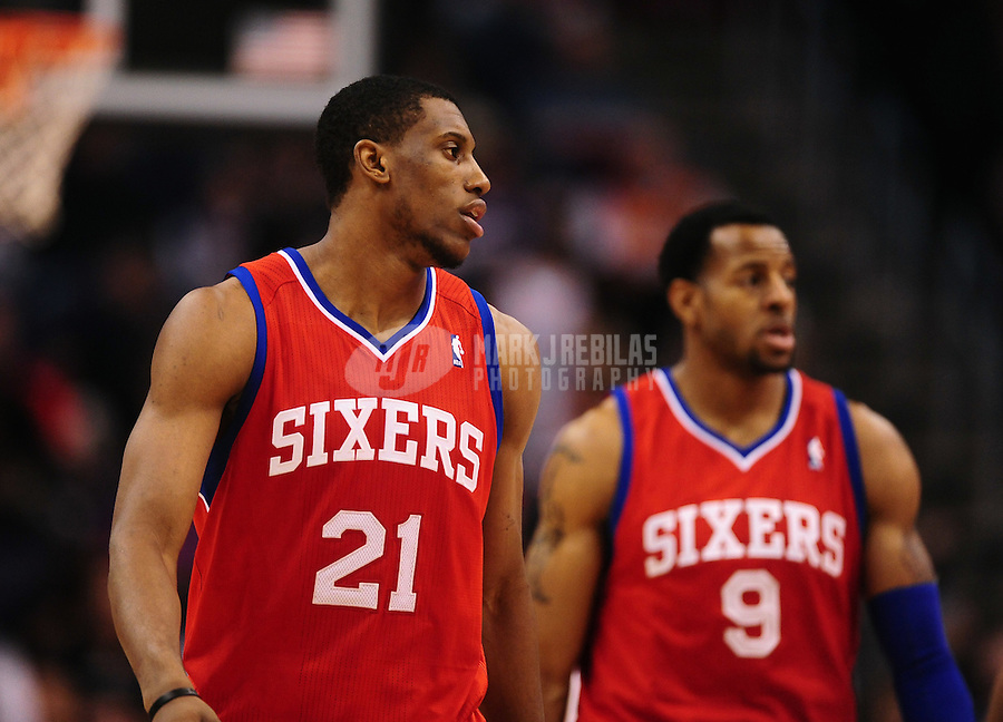 Dec. 28, 2011; Phoenix, AZ, USA; Philadelphia 76ers teammates Thaddeus Young (left) and Andre Iguodala during game against the Phoenix Suns at the US Airways Center. The 76ers defeated the Suns 103-83. Mandatory Credit: Mark J. Rebilas-USA TODAY Sports