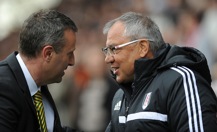 Fulham's Manager Felix Magath greets Norwich City's Manager Neil Adams <br /> <br /> Photo by Ashley Western/CameraSport<br /> <br /> Football - Barclays Premiership - Fulham v Norwich City - Saturday 12th April 2014 - Craven Cottage - London<br /> <br /> &copy; CameraSport - 43 Linden Ave. Countesthorpe. Leicester. England. LE8 5PG - Tel: +44 (0) 116 277 4147 - admin@camerasport.com - www.camerasport.com