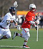Dan Rooney #26 of Smithtown East, right, gets pressured by Frank Callan #2 of Massapequa during the second quarter of a non-league varsity boys lacrosse game at Burns Park on Saturday, Mar. 26, 2016. Smithtown East won by a score of 17-16.