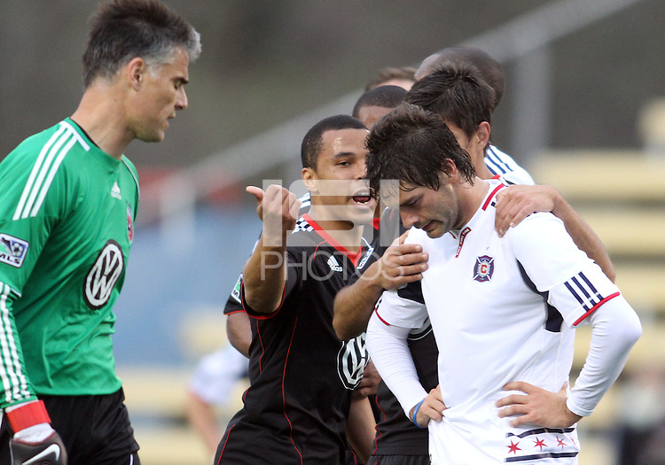 Charlie Davis#9 of D.C. United tells Diego Chaves#99 of the Chicago Fire to get off the field after he received a red card during a second round match of the Carolina Challenge on March 9 2011 at Blackbaud Stadium, in Charleston, South Carolina. D.C. United won 1-0.