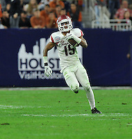 NWA Media/Michael Woods --12/29/2014-- w @NWAMICHAELW...University of Arkansas corner back Henre' Toliver returns an interception late in the 4th quarter of Monday night win over the University if Texas at the Texas Bowl at NRG Stadium in Houston.