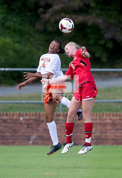 Morgan Stith (4) of Maryland goes up for a header with Ashley Spivey (8) of Maryland upfield during the game at Klockner Stadium in Charlottesville, VA.  Virginia defeated Maryland, 1-0.