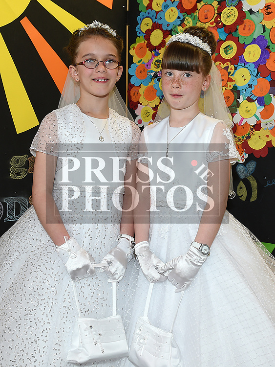 Sisters Holly and Heather Kierans from St Brigids school who recieved first holy communion in Our Lady of Lourdes church. Photo:Colin Bell/pressphotos.ie